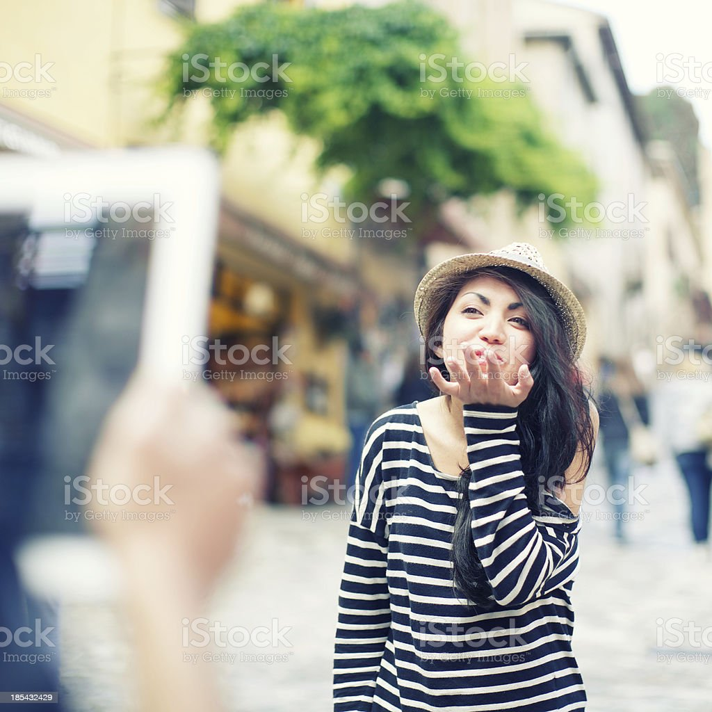 Boyfriend take a photo with digital tablet to his girlfriend royalty-free stock photo