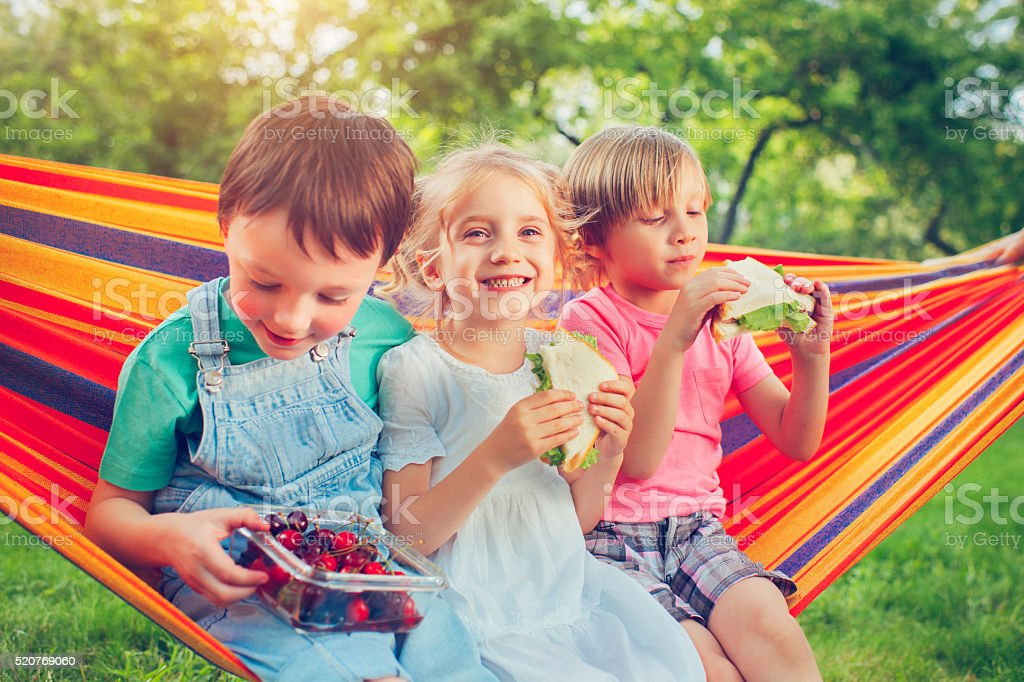 Boys and girl in summer stock photo