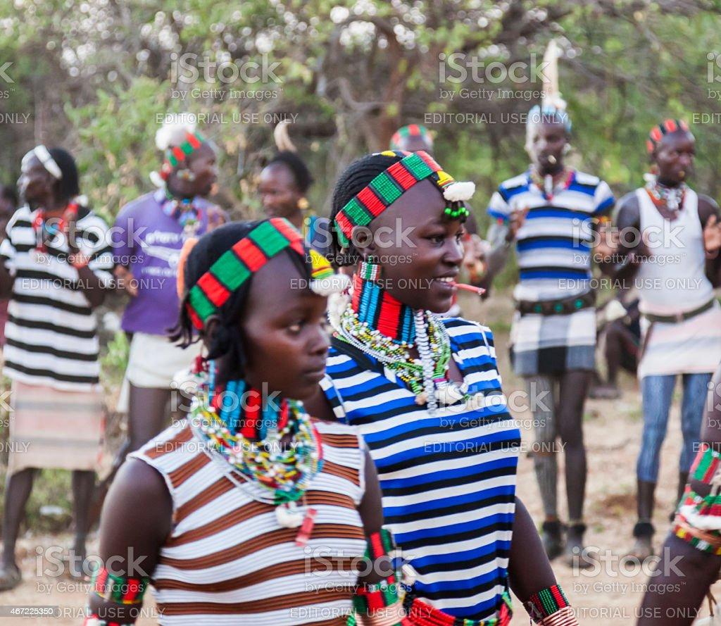 Boys and girls at the traditional evangaty ceremony. Turmi, Ethiopia. stock photo
