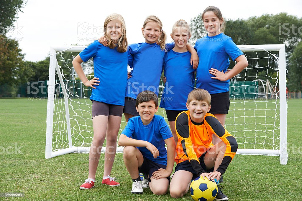Boys And Girls In Elementary School Soccer Team stock photo