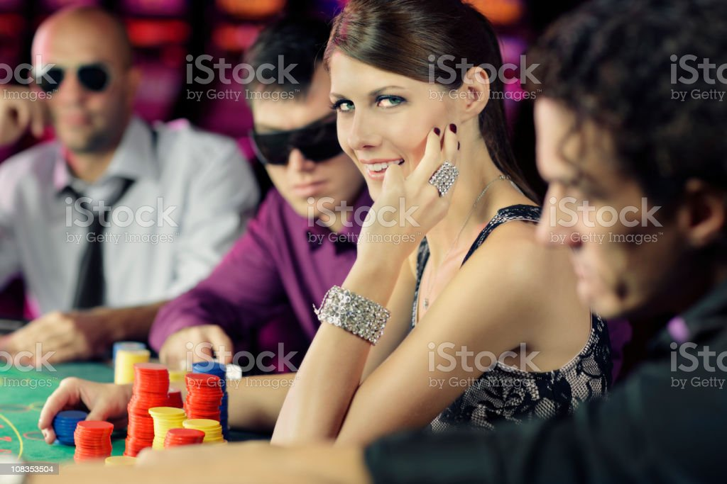 boys and girls playing poker  in casino stock photo