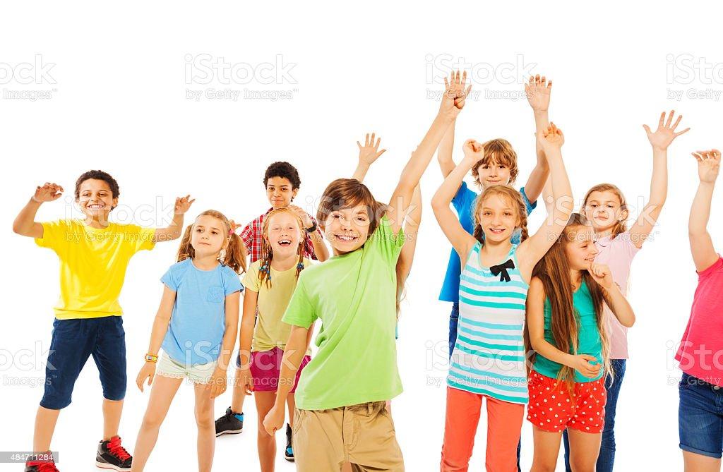 Boys and girls very happy raising hands stock photo