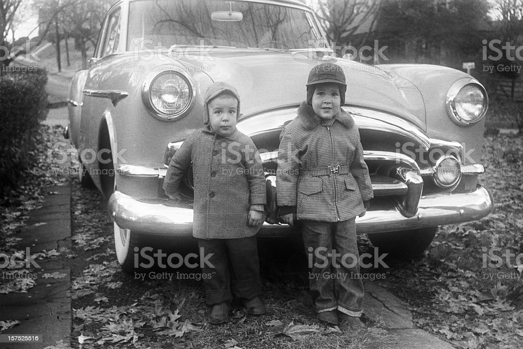 boys and Packard coupe car 1955, retro stock photo