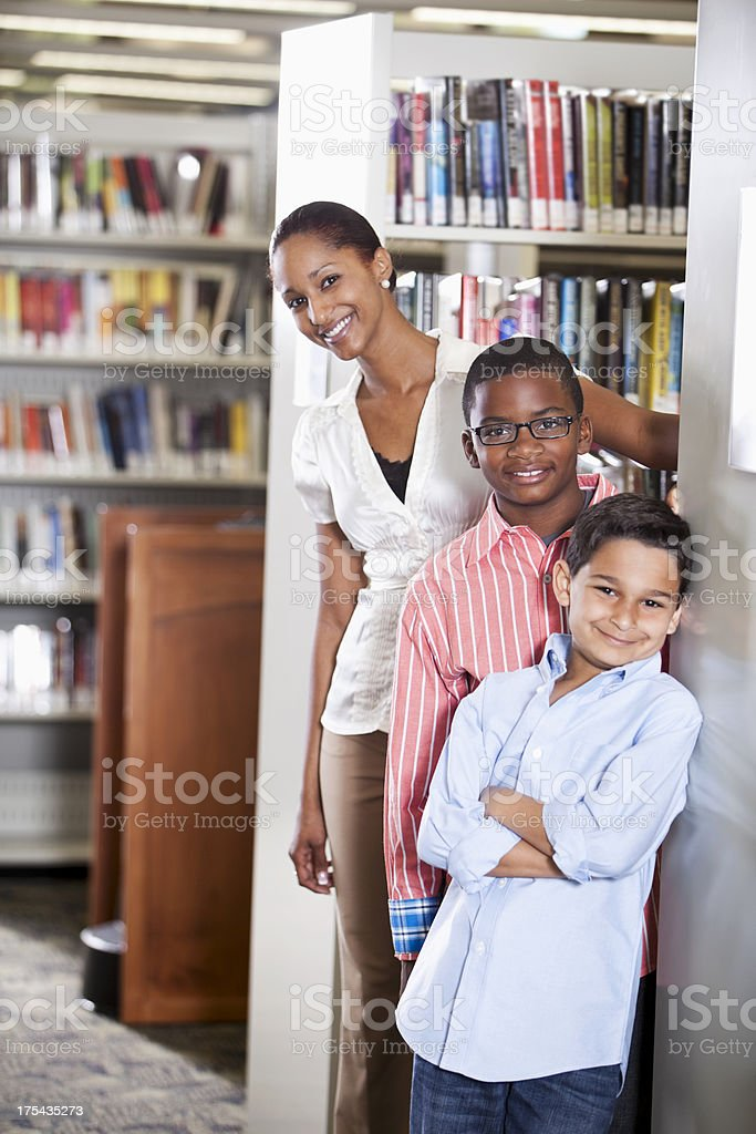 Boys and teacher at library royalty-free stock photo