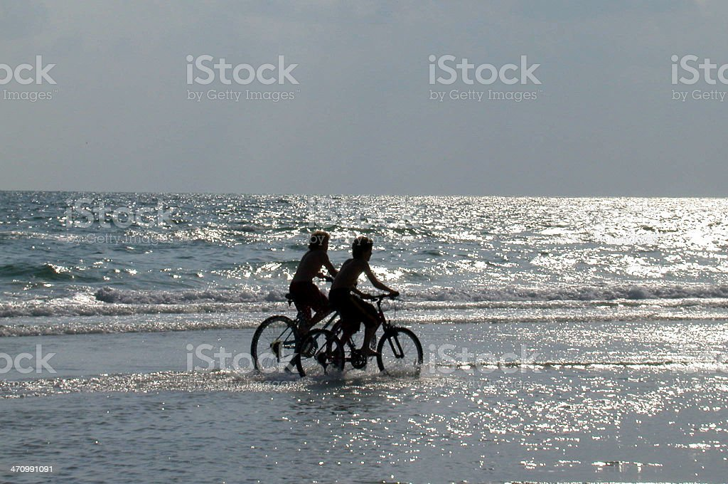 Boys, Bikes, and the Ocean stock photo