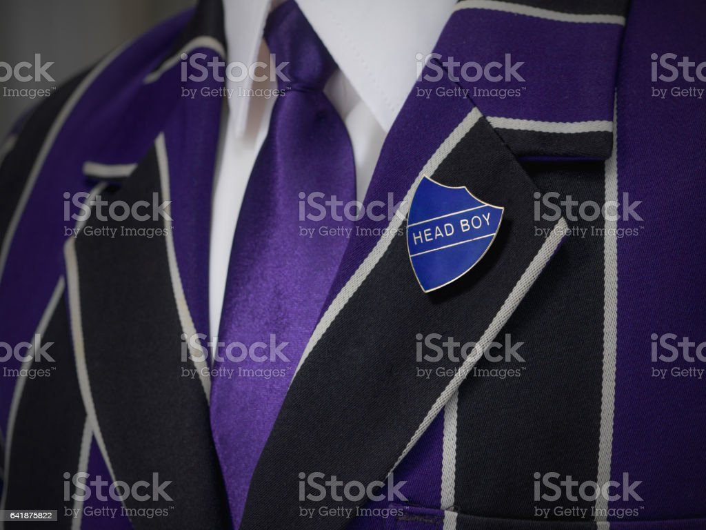 Boys blazer with school blue head boy badge stock photo