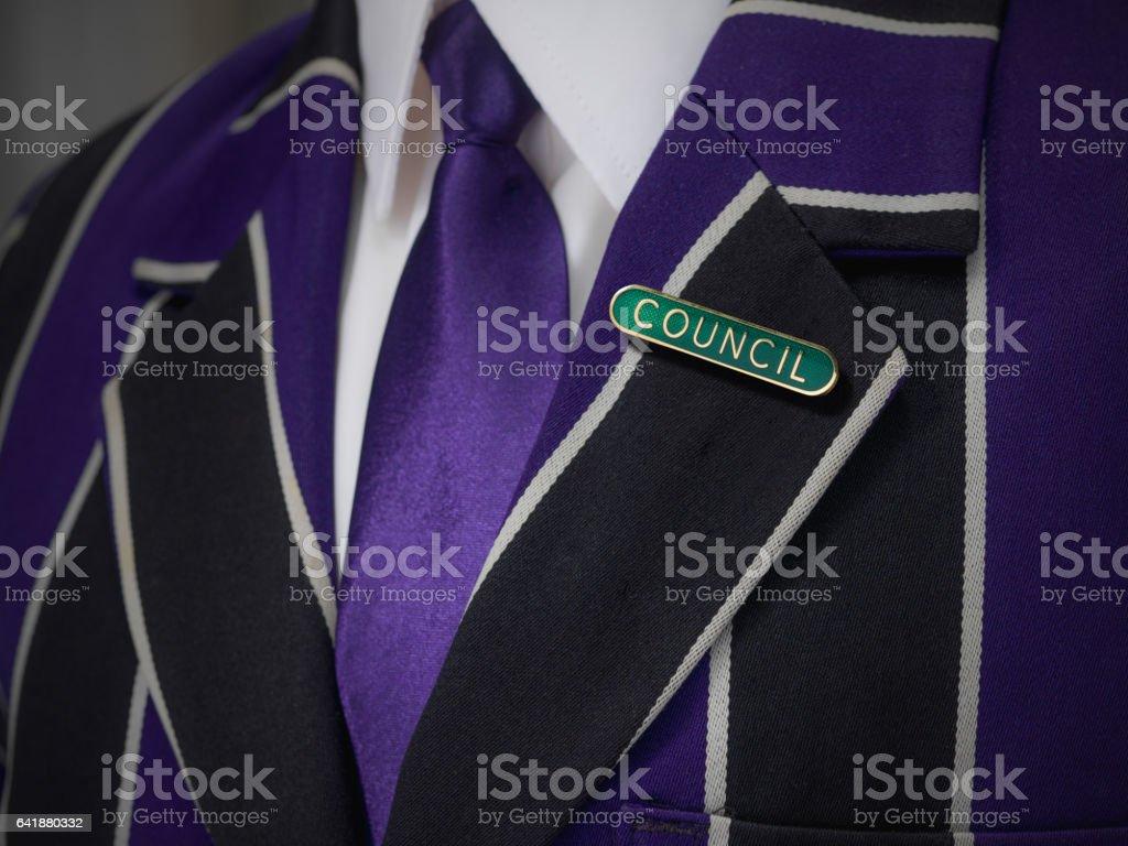 Boys blazer with school green council badge stock photo