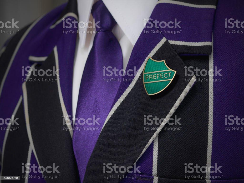 Boys blazer with school green prefect badge stock photo