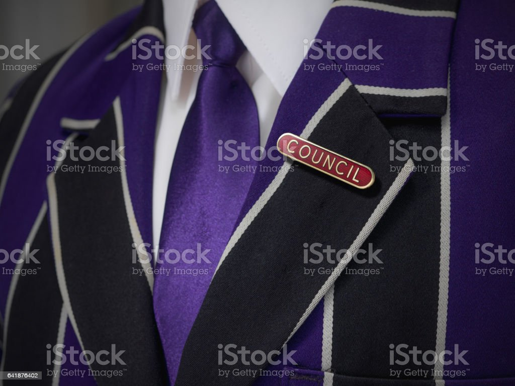 Boys blazer with school red council badge stock photo