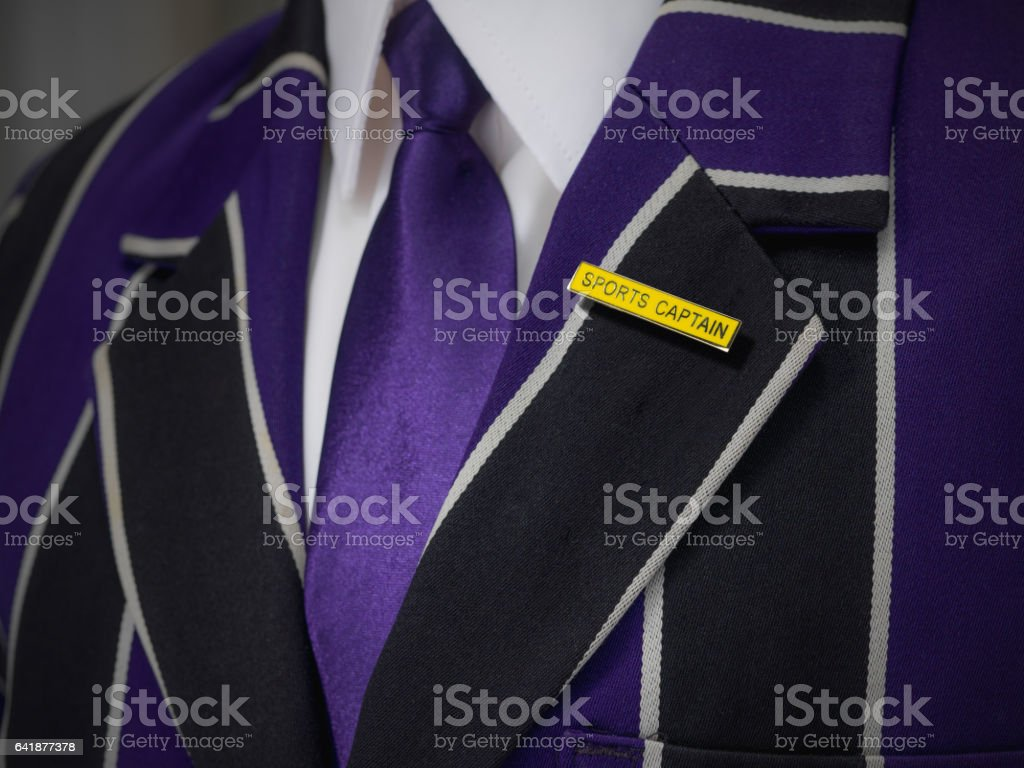 Boys blazer with school yellow sports captain badge stock photo