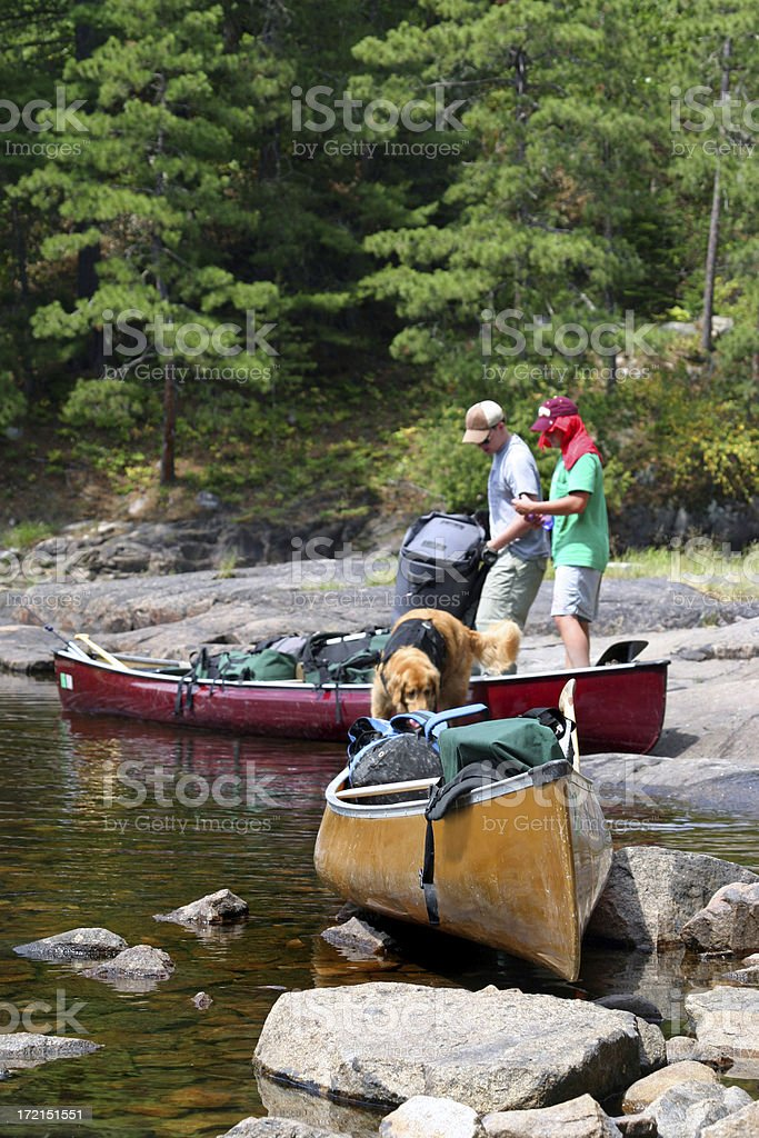Boys canoeing in the Boundary Waters royalty-free stock photo