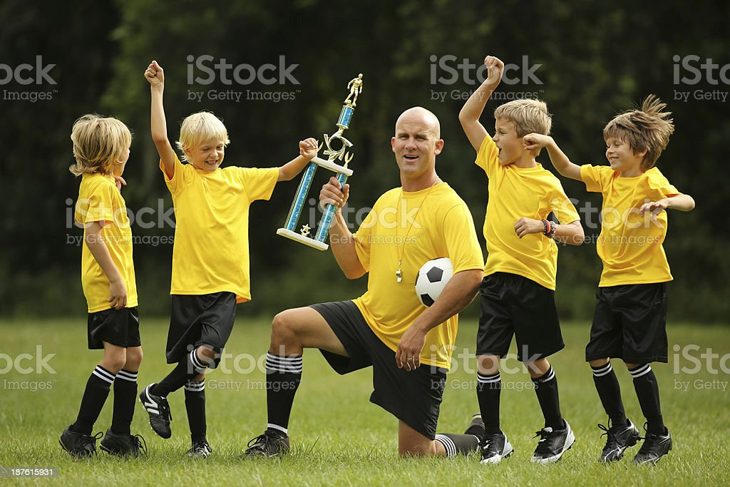 Boys Cheering And Celebrating On Soccer Field royalty-free stock photo