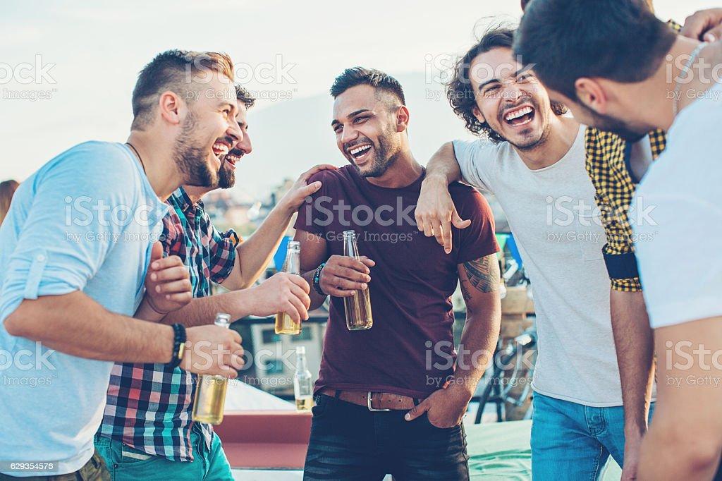 Boys drinking beer and having fun stock photo