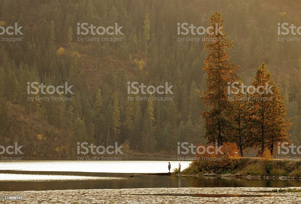 Boys fishing at Fernan Lake Idaho royalty-free stock photo