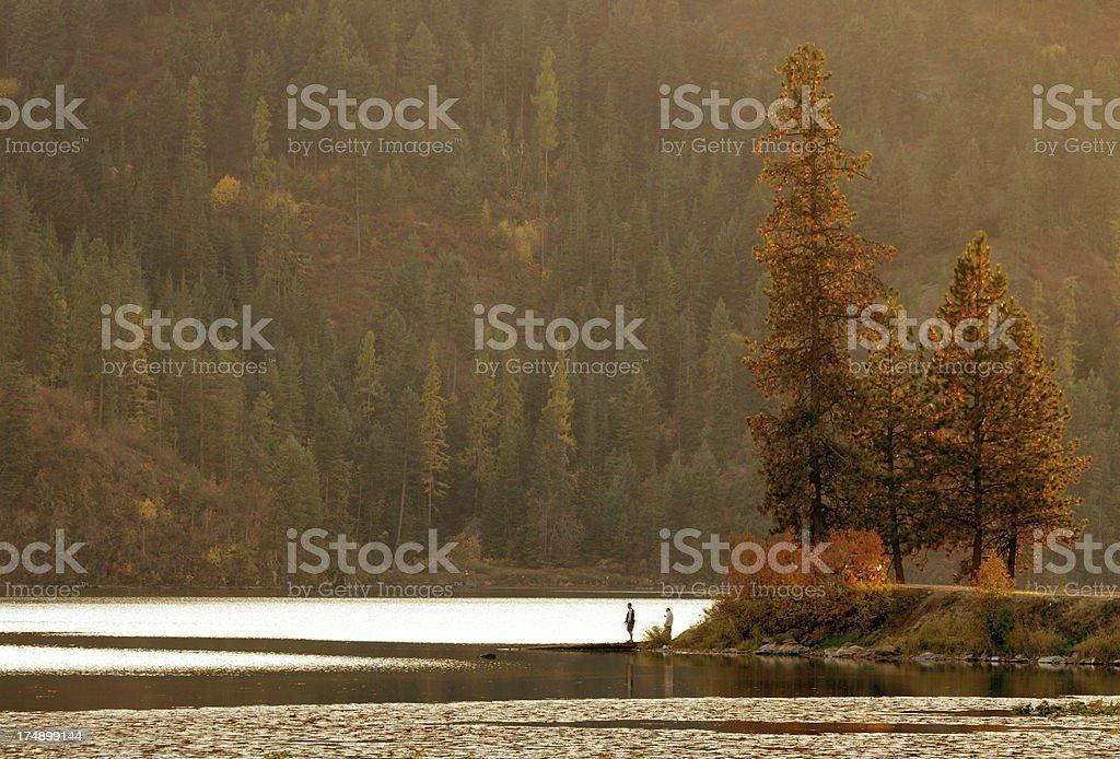 Boys fishing at Fernan Lake Idaho stock photo