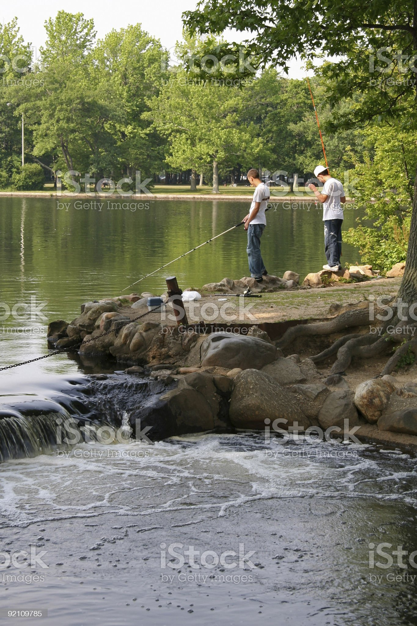 Boys fishing on the lake royalty-free stock photo