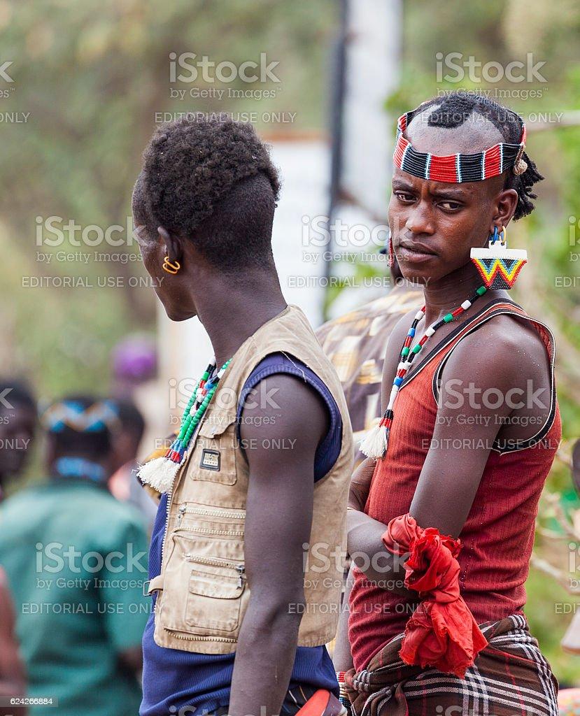 Boys from Ari tribe at village market. Bonata. Omo Valley. stock photo