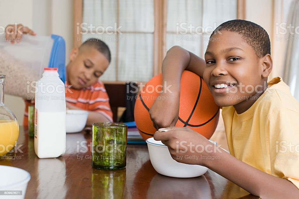 Boys having breakfast stock photo