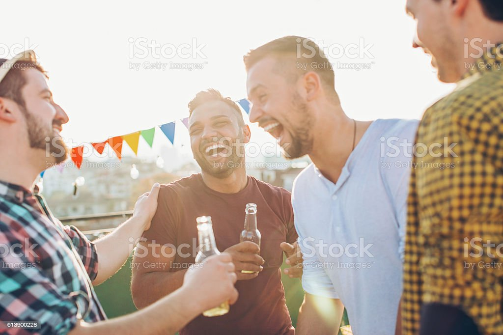 Boys having drinks and fun stock photo