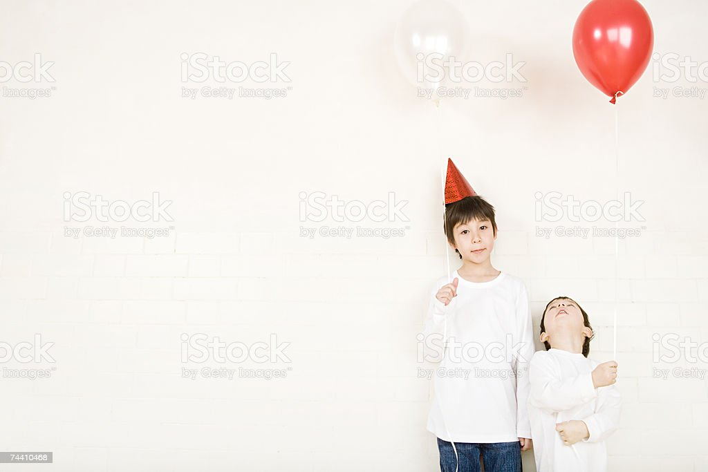 Boys holding balloons stock photo