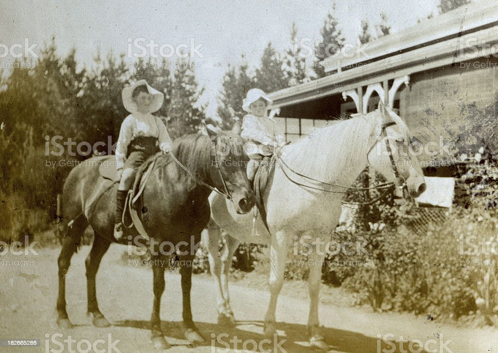 Boys horse riding royalty-free stock photo