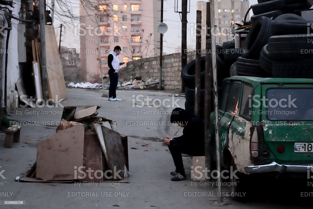 Boys in Baku, bored whilst waiting to light Nowruz fire stock photo