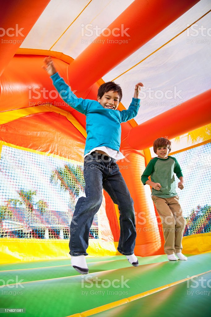 Boys in bounce house stock photo