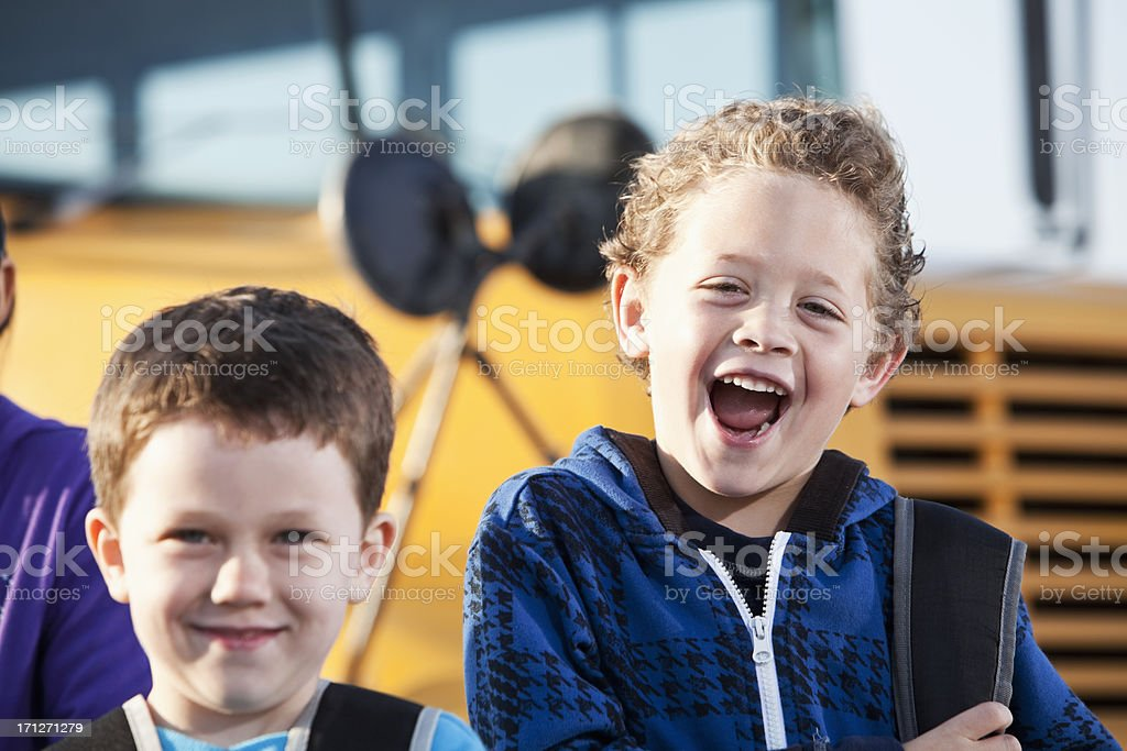 Boys in front of school bus royalty-free stock photo
