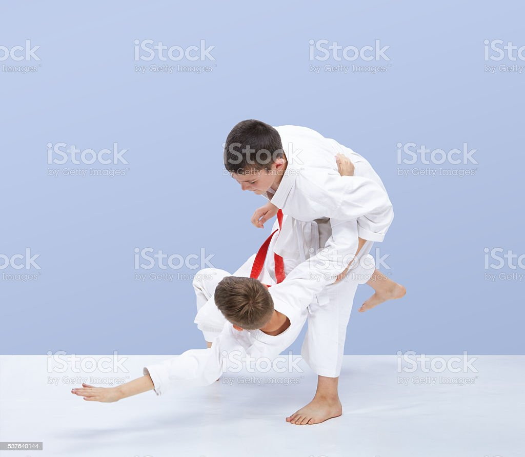Boys in judogi are training throws stock photo