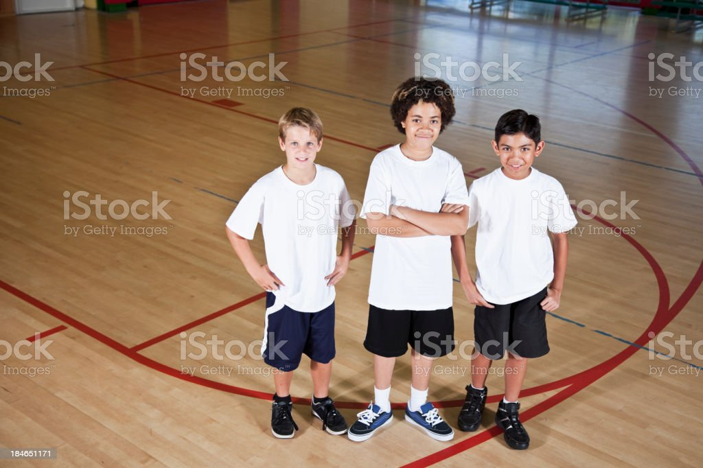 Boys in school gymnasium stock photo