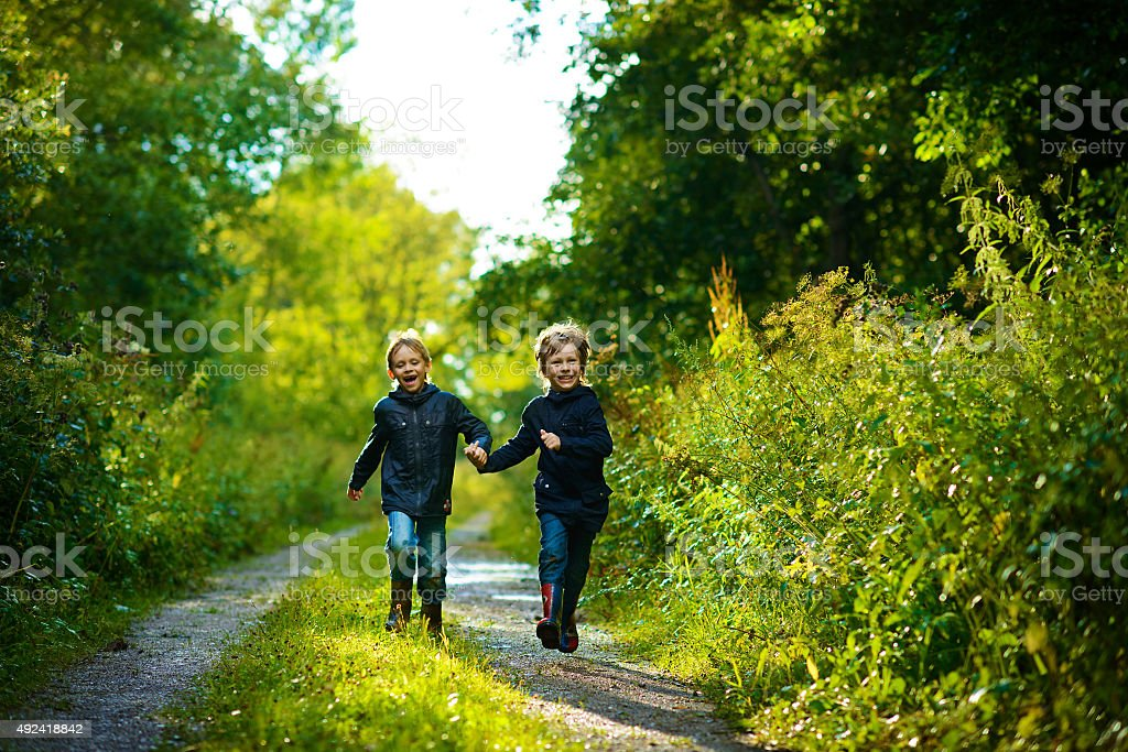 Boys in summer forest after rain stock photo