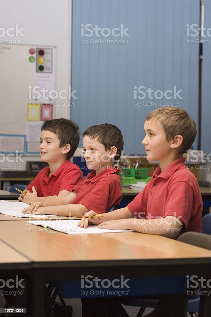 Boys listening in class 2 royalty-free stock photo