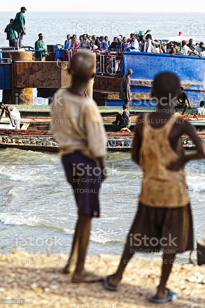 Boys looking at crowd. stock photo