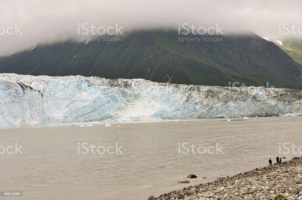 boys observe glacier closeup stock photo