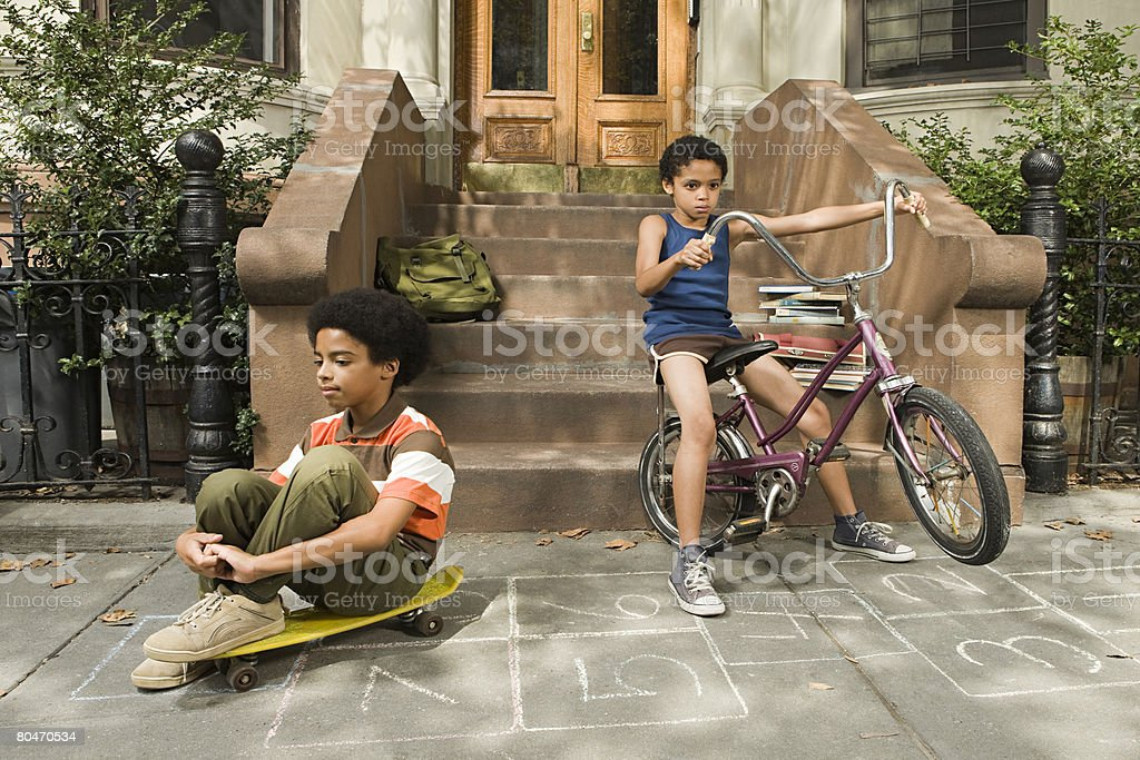 Boys on sidewalk royalty-free stock photo