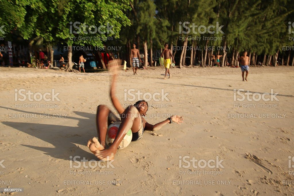 Boys play at the Beach of Grand Baie, Mauritius, Africa stock photo
