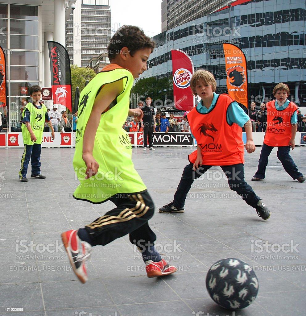 Boys play soccer royalty-free stock photo