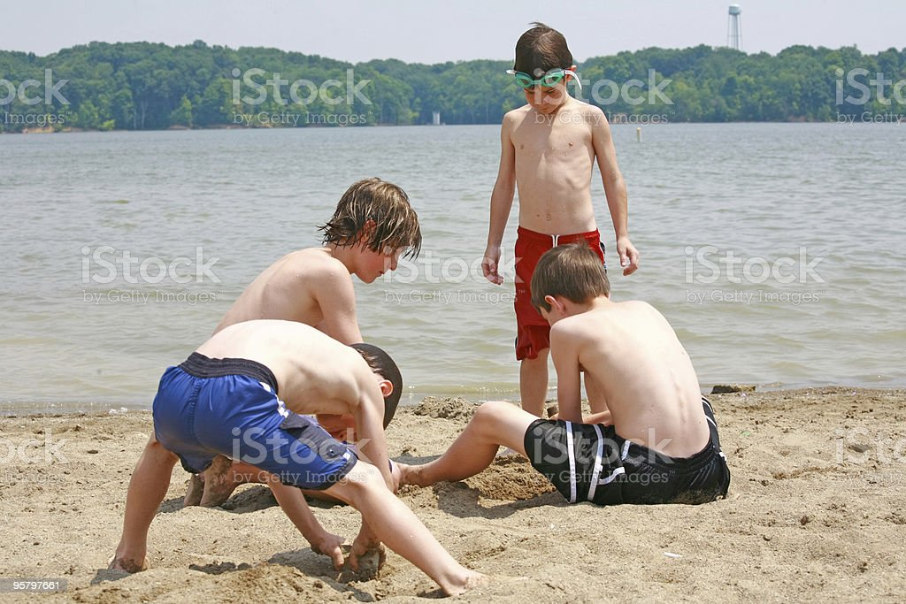 Boys Playing at the Beach royalty-free stock photo