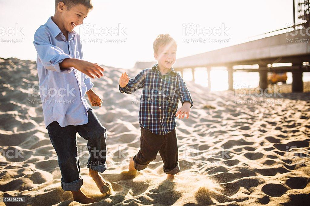 Boys Playing at Venice Beach stock photo