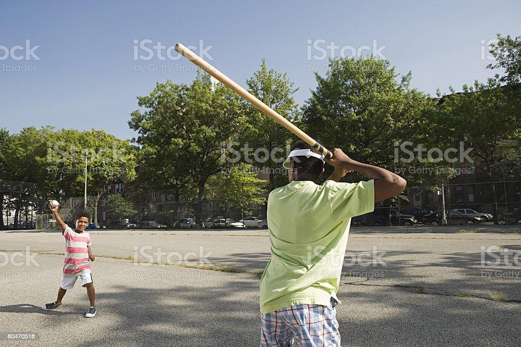 Boys playing baseball royalty-free stock photo