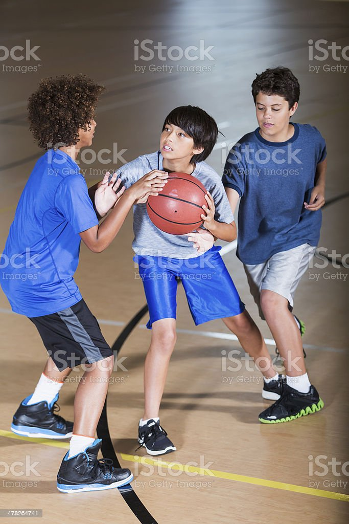 Boys playing basketball royalty-free stock photo