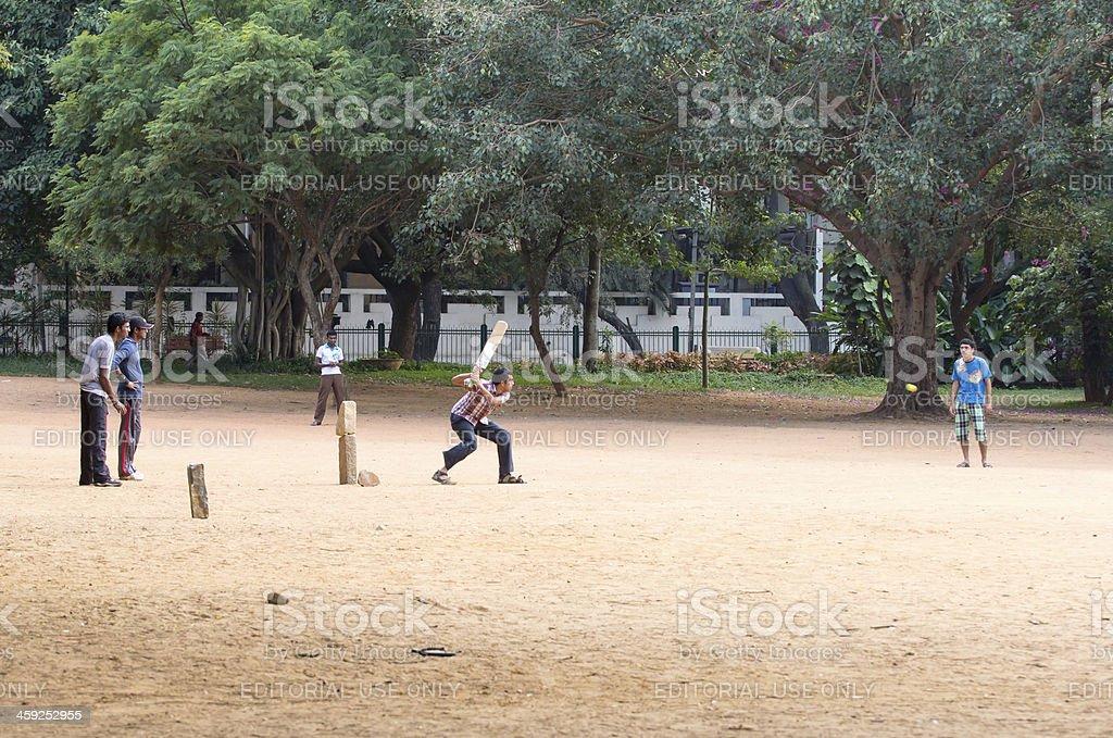 Boys playing cricket in Bangalore, India stock photo
