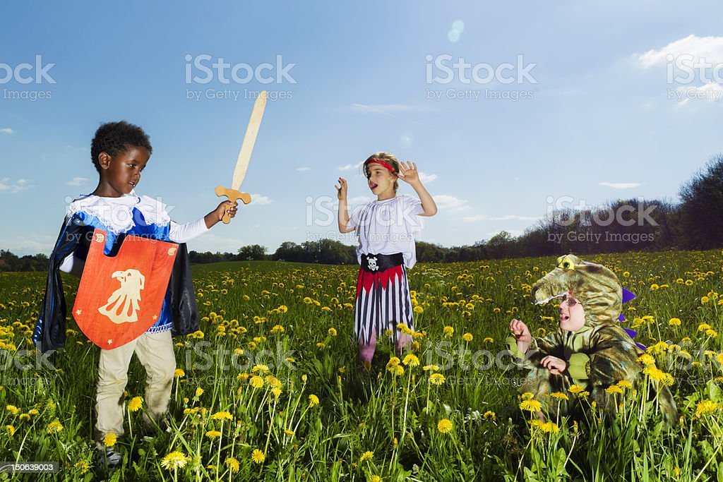 Boys playing dress up outdoors stock photo