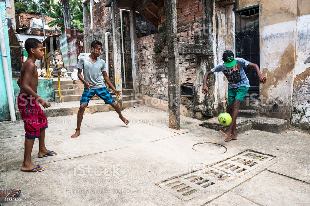 Boys playing football in the poor neighbourhoood, Salvador, Bahia, Brazil stock photo