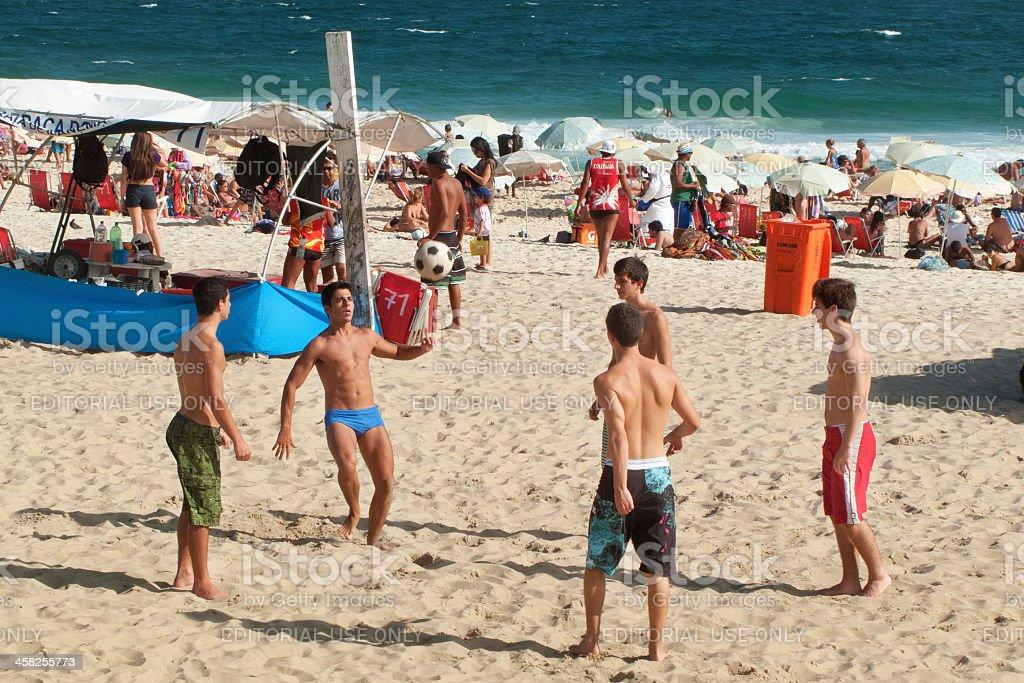 Boys playing soccer in Ipanema Beach royalty-free stock photo