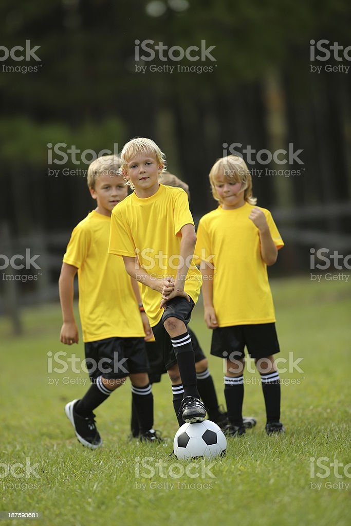 Boys Playing Soccer On Field royalty-free stock photo