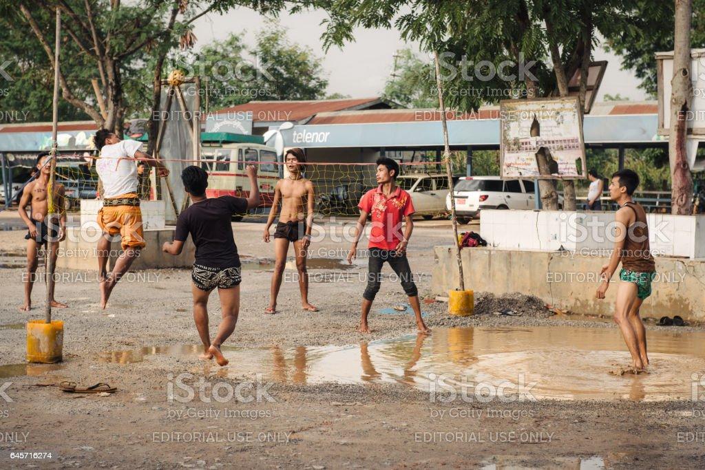 Boys playing traditional asian sport game sepak takraw stock photo