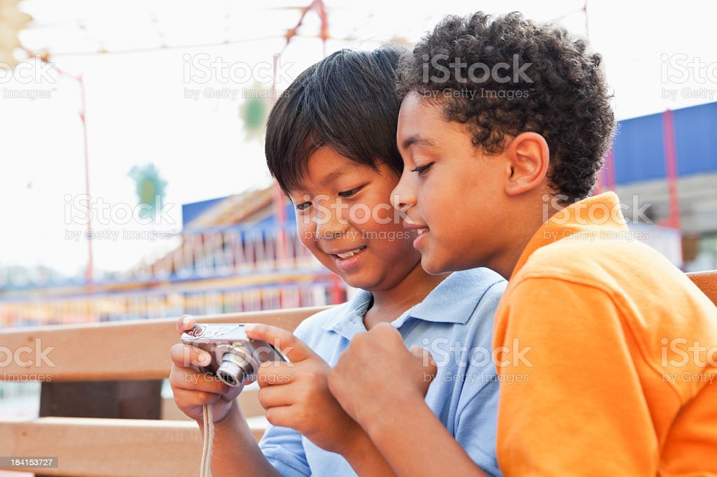 Boys playing with digital camera stock photo