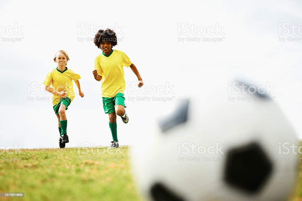 Boys practicing football on the field royalty-free stock photo