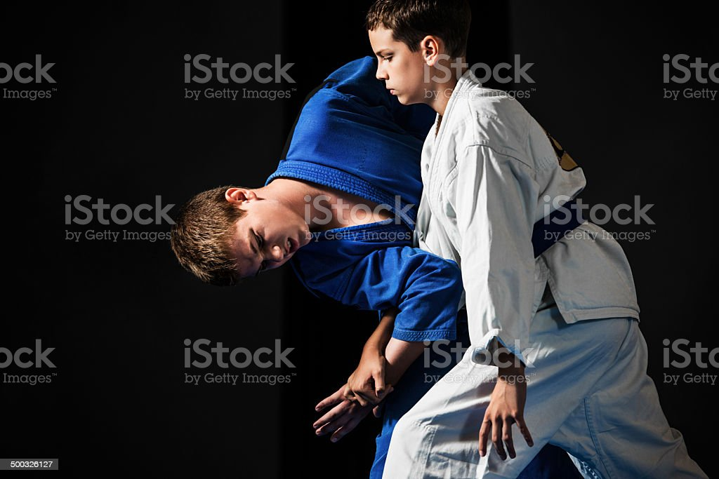 Boys practicing karate. stock photo